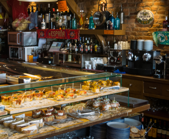 the-bar-and-one-of-three-counters-displaying-tapas-locally-called-pinchos-for-selection-at-casa-lita-in-santander-spain